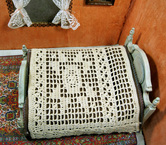 Delicate dollhouse afghan worked in ecru crochet thread