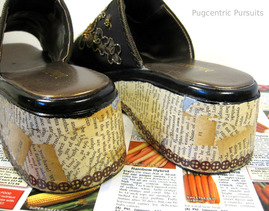 Decoupaged old book pages on to platform sandals