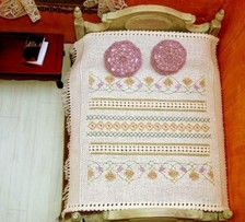 Delicate embroidered dollhouse bedspread