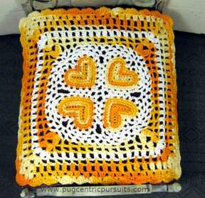 Yellow orange miniature dollhouse bedspread with tiny hearts