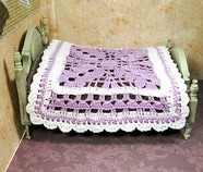 Purple crochet miniature dollhouse bedspread