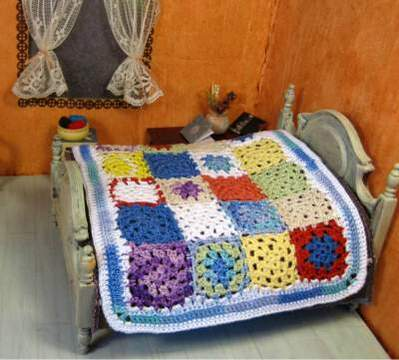 Miniature patchwork bedspread for dollhouse
