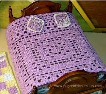 Filet crochet dollhouse bedspread worked in lavender thread