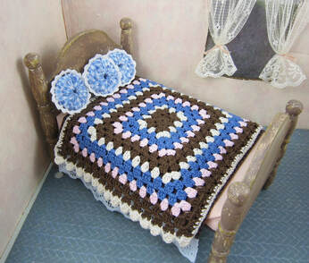 Miniature bedspread with granny square styling