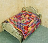 Miniature crochet dollhouse bedspread worked granny square style