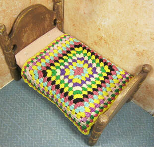 Miniature crochet bedspread with granny square styling
